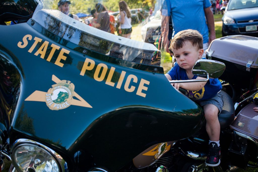 Peter Knoll, 2, of Bow checks out a State Police motorcycle during National Night Out at Rollins Park in Concord on Tuesday, August 1, 2017. (ELIZABETH FRANTZ / Monitor staff) ELIZABETH FRANTZ
