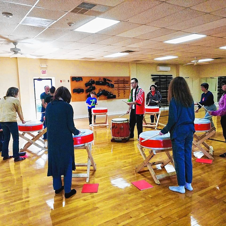 Hokuto Taiko Dojo founder and instructor Jason Seymore (center) teaches a group of first-timers about Japanese Taiko drumming at his dojo in Londonderry. He'll be teaching and performing at Keach Park this Thursday at 6 p.m. Courtesy of Hokuto Taiko Dojo