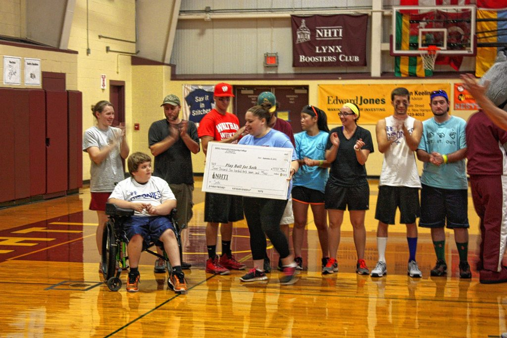 "Seth Peake, 10, is presented a check for more than $7,100 at NHTI's Play Ball for Seth Wiffle Ball Tournament at NHTI on Sunday. Peake was diagnosed with hemophilia before he was born, and the Wiffle Ball tournament was a fundraiser to help with his medical costs. Below: Jon goes yard in the ""Monitor/Insider"" team's first game, although it didn't help in the end (photo by Aimee Larochelle)."