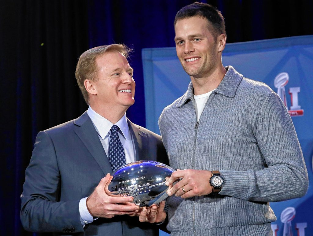 NFL commissioner Roger Goodell and New England Patriots quarterback Tom Brady pose with the MVP trophy during a news conference after the NFL Super Bowl 51 football game Monday, Feb. 6, 2017, in Houston. Brady was named the MVP of Super Bowl 51. (AP Photo/Morry Gash) Morry Gash