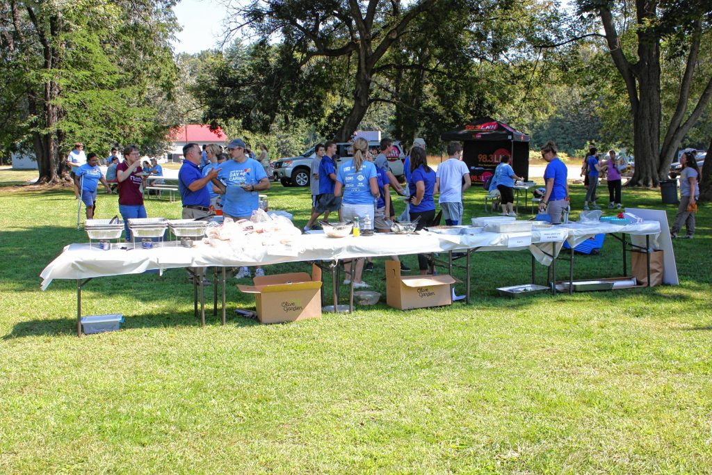 Volunteers and organizers with Granite United Way socialize at Kiwanis Riverfront Park during a kickoff luncheon to celebrate the nonprofit organization's annual Day of Caring last Wednesday. In all, more than 500 volunteers participated in the daylong event. JON BODELL / Insider staff