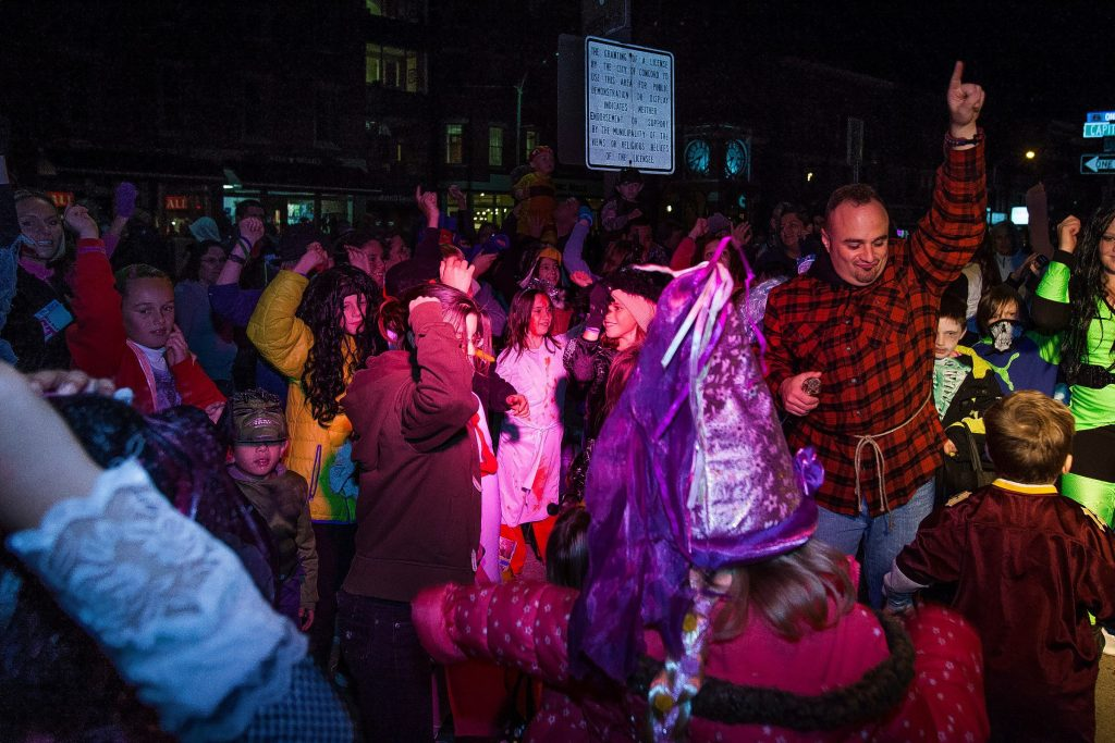 DJ Nazzy (right) leads a dance party during the annual Downtown Halloween Howl on Main Street in Concord on Friday, Oct. 24, 2014.  (ELIZABETH FRANTZ / Monitor staff) ELIZABETH FRANTZ