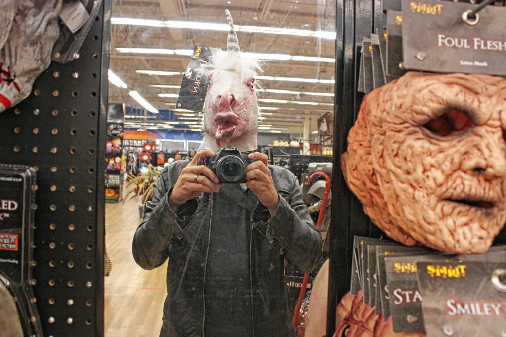 I tried this unicorn mask on for size. While it sort of fit, it was nearly impossible to see while wearing the thing, and even harder to breathe. It's a small price to pay for a funny picture.  JON BODELL / Insider staff