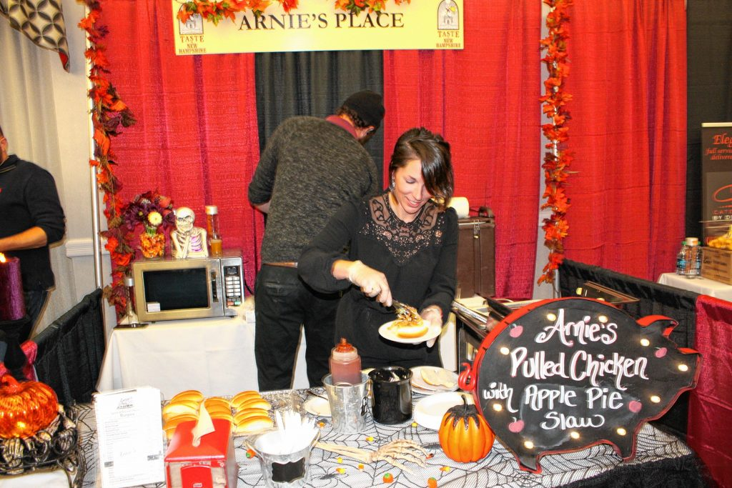 Kaitlyn Witts of Arnie's Place whips up a pulled chicken with apple pie slaw sandwich at the Taste of New Hampshire event at the Grappone Conference Center last Thursday. JON BODELL / Insider staff