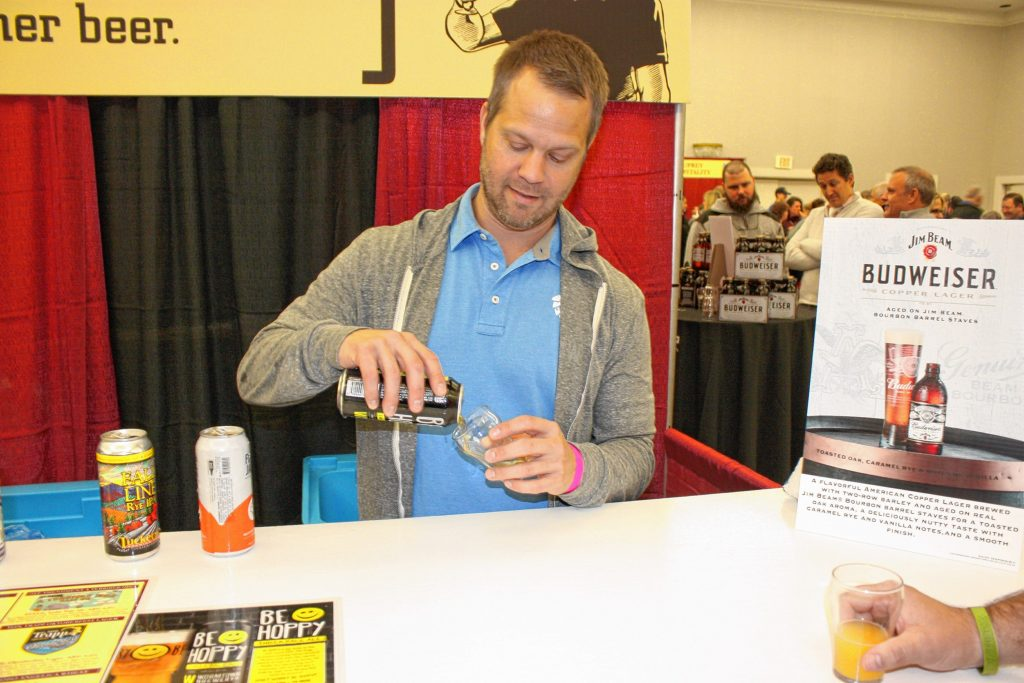 David Norkus with Wormtown Brewery in Worcester, Mass., pours a taster of Be Hoppy IPA at the Taste of New Hampshire event at the Grappone Conference Center last Thursday. JON BODELL / Insider staff