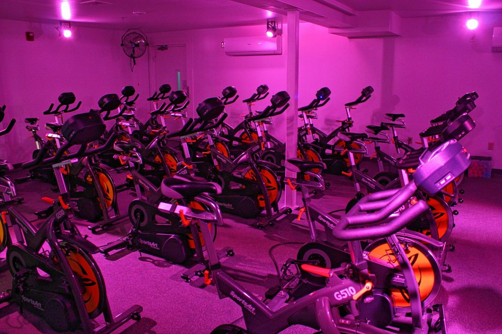 The cycling studio at 43 Degrees North Athletic Club is rigged with colored lights that can be set up to pulse to the beat of the music that plays during cycling sessions. The lighting and the music really help set the atmosphere in the room. JON BODELL / Insider staff