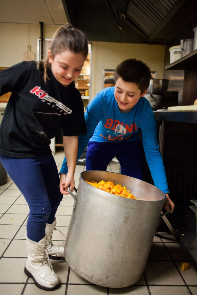 Eigth-year-old Ava and Aiden Terrio, 10, try to lift a pot full of butternut squash approaching 100 lbs ahead of the traditional Thanksgiving dinner at the Windmill Family Restaurant in Concord on Wednesday, Nov. 22, 2017. (ELIZABETH FRANTZ / Monitor staff) Elizabeth Frantz