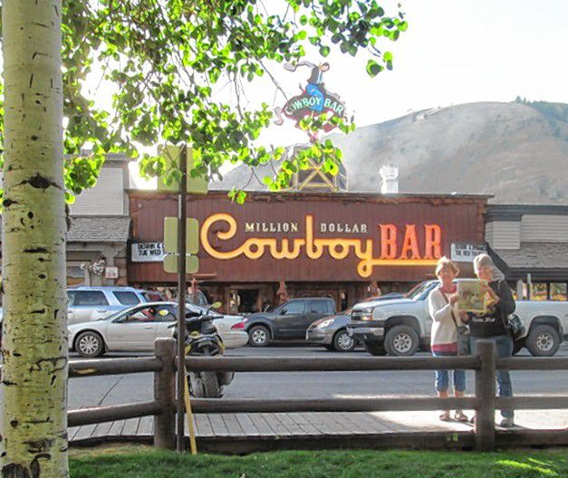"""After a nearly 2,000-mile road trip visiting three National Parks in Idaho, Montana and Wyoming, longtime friends Margaret Harlan and Liz Dane rode up to the Million Dollar Cowboy Bar in Jackson Hole, Wy. They had to leave their """"horses"""" outside but were able to hop on their saddles at the bar. Yes, all the bar seats are real horse saddles, Dane said. Courtesy of Liz Dane"""