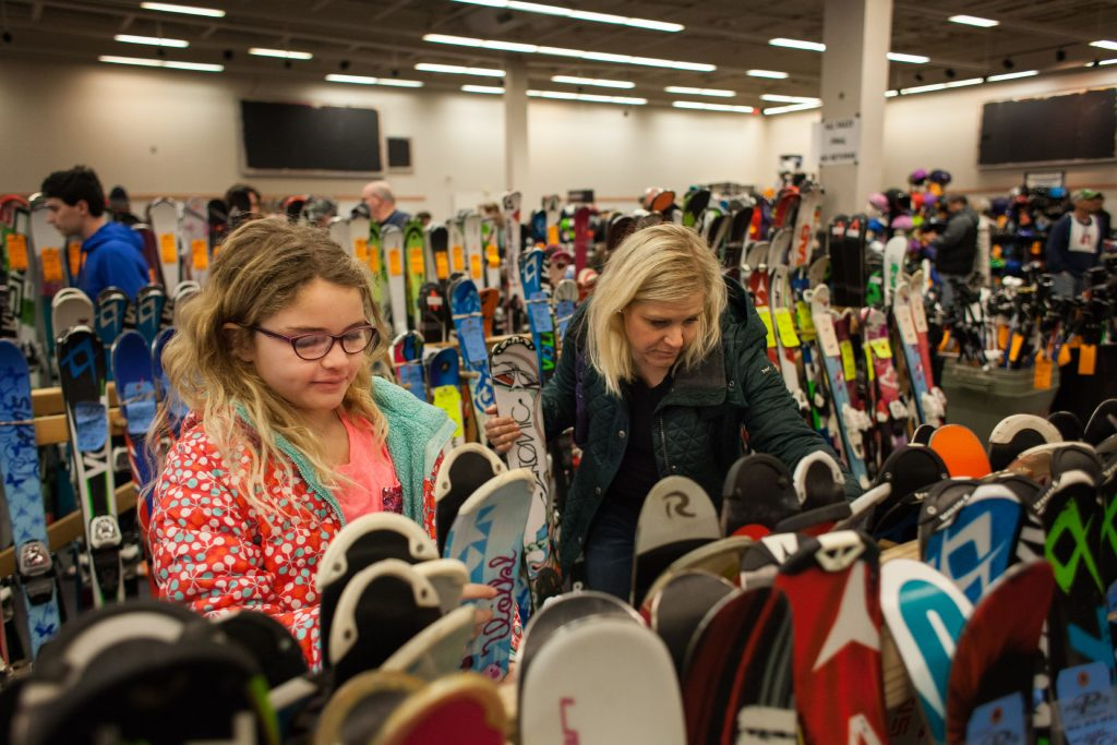 Kristin Phillips (right) of Concord and her 10-year-old daughter Grace Smith shop for Grace's next pair of skis during Concord's annual Ski and Skate sale at the Steeplegate Mall on Saturday, Dec. 3, 2016 (ELIZABETH FRANTZ / Monitor staff) Elizabeth Frantz