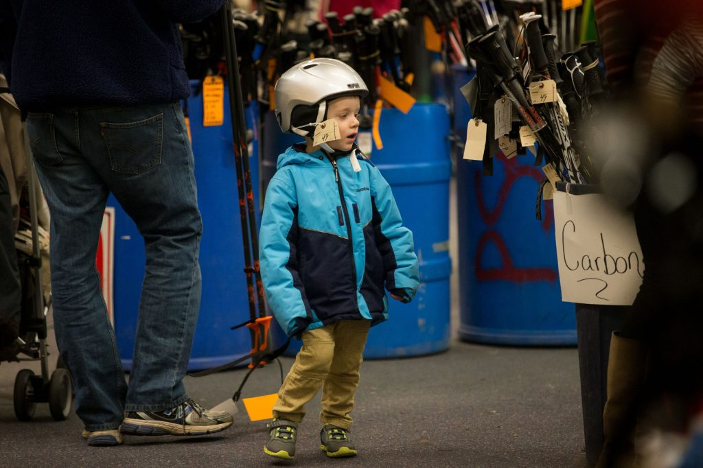 Wearing his new helmet, 3-year-old James Ransmeier of Concord and his family walk around the Capital Ski and Outing Club's annual ski and skate sale at Steeplegate Mall in Concord on Saturday, Dec. 2, 2017. (ELIZABETH FRANTZ / Monitor staff) Elizabeth Frantz