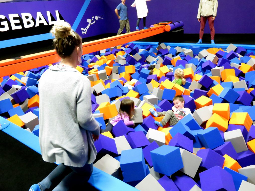 Sarah Palmer watches her son, Ronnie, play in a foam pit at Altitude Trampoline Park in Concord's Steeplegate Mall. Caitlin Andrews