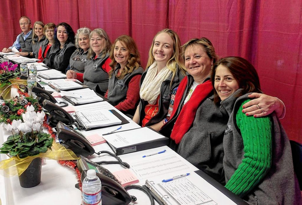 This is just a small portion of the dozens of phone bank workers who volunteered at last year's Boys & Girls Clubs of Greater Concord's annual TV Auction. Courtesy of Boys & Girls Clubs of Greater Concord