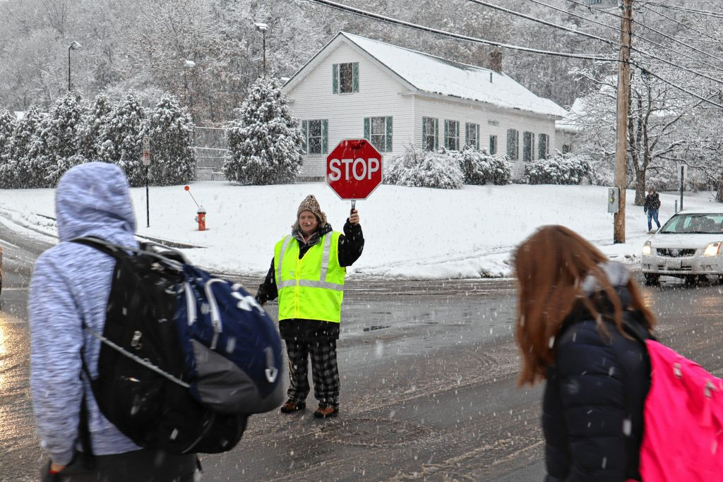 Crossing guard Rose Baker, 58, helps students cross Warren Street on Tuesday.