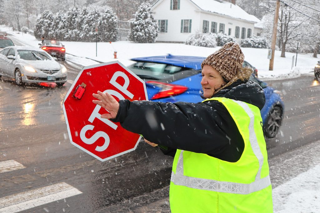 Rose Baker prepares to stop cars on Warren Street recently so students can cross. Baker has been nominated for America's Favorite Crossing Guard.