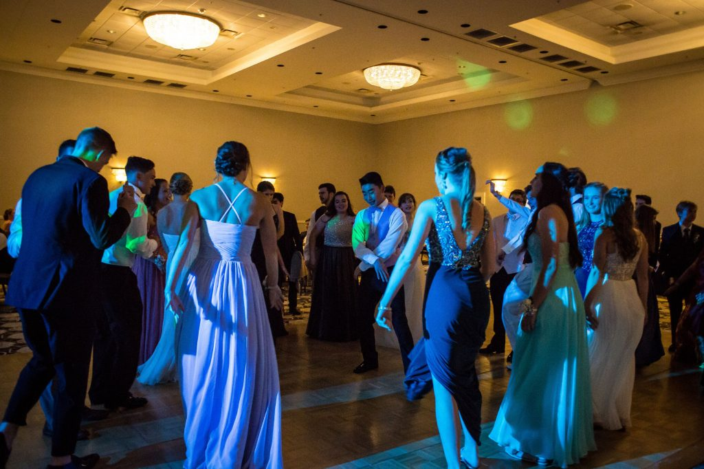 "Bishop Brady students dance to the music during prom at the Grappone Conference Center in Concord on Friday, May 18, 2018. This year's theme was ""Nautical Nights."