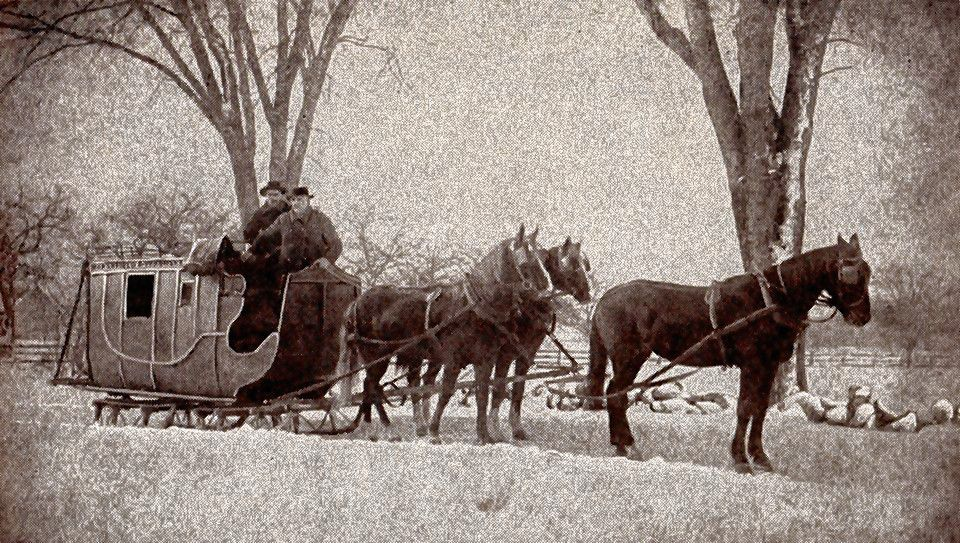 A horse-drawn sleigh pulls a pair of men through Concord in the 1890s. Courtesy of Jim Spain