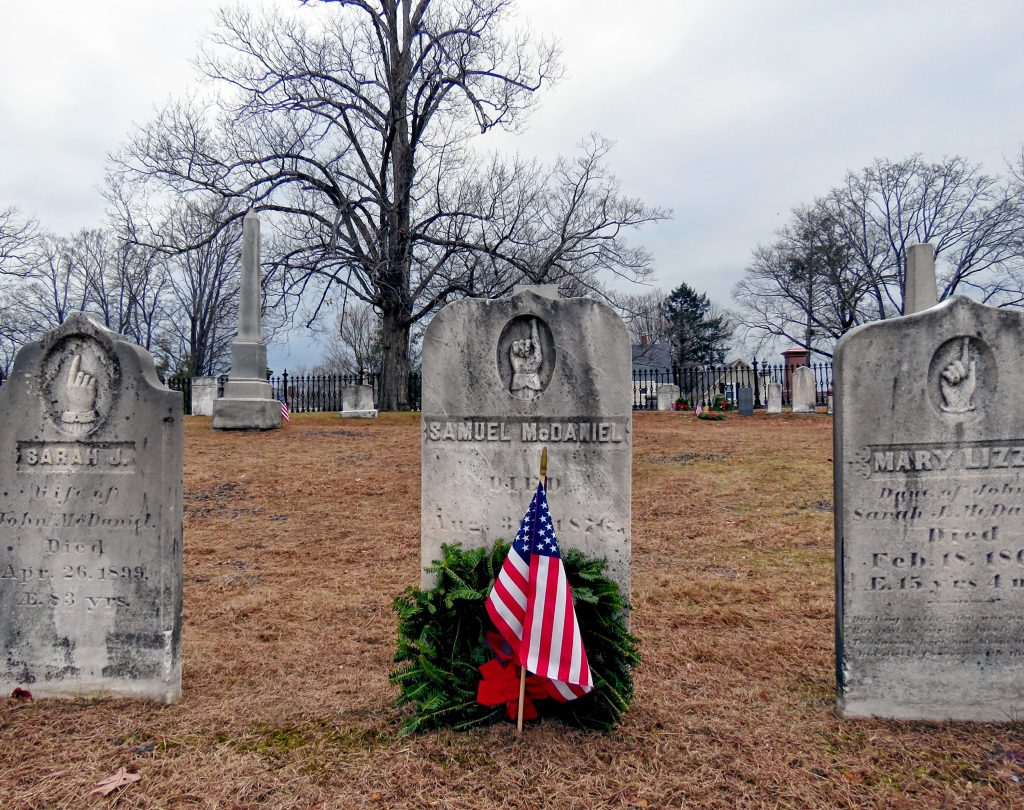 Wreaths meant to honor veterans at the Old North Cemetery in Concord are shown on the morning of Friday, Dec. 14, 2018. Caitlin Andrews