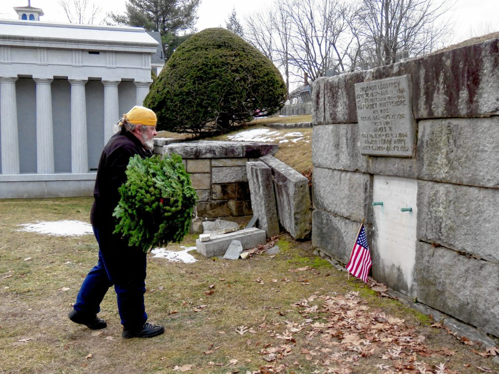 Matthew Wieczhalek-Seiler prepares to lay wreaths at veteran graves in Old North Cemetery in Concord Friday morning. Caitlin Andrews