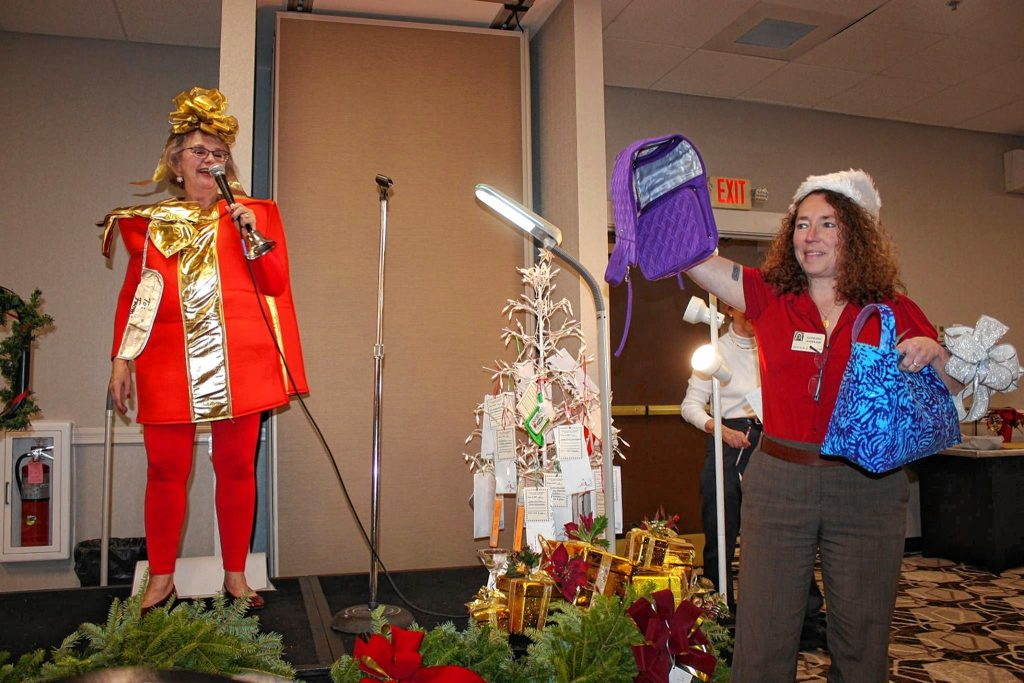 One of the highlights of the Zonta Club of Concord's Holiday Auction is seeing auctioneer Janice Severance (left) dressed up in some sort of holiday-themed costume.  Courtesy of Zonta Club of Concord