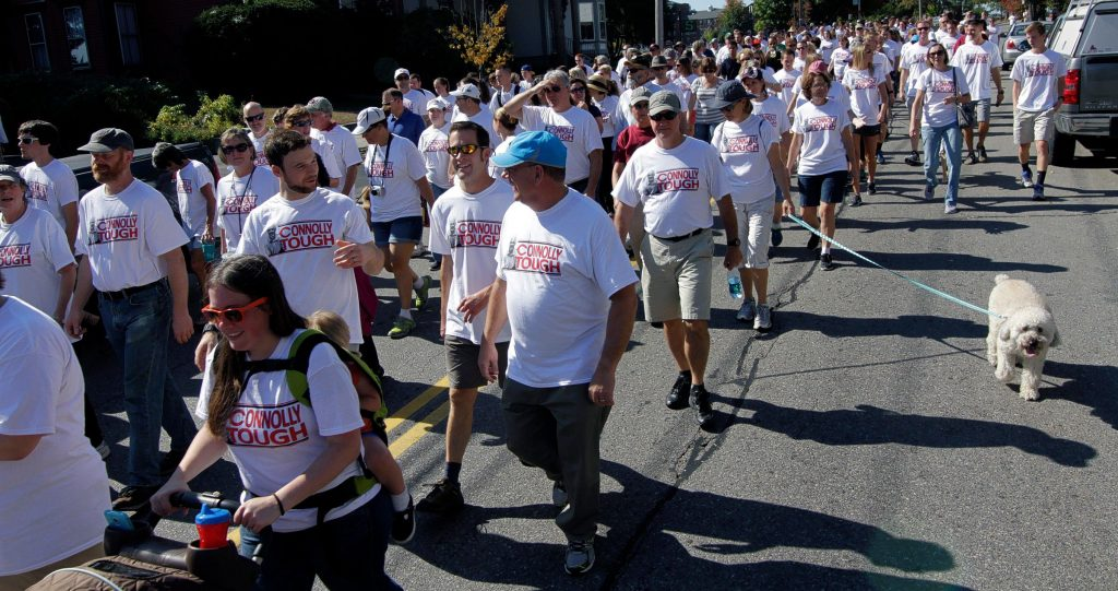 Participants in the ALS walk parade down Pleasant Street Saturday morning in support of Concord High School Principal Gene Connolly.  (GEOFF FORESTER / Monitor staff) Participants in the ALS walk head down Pleasant Street yesterday morning in support of Concord High School Principal Gene Connolly.(GEOFF FORESTER / Monitor staff) GEOFF FORESTER