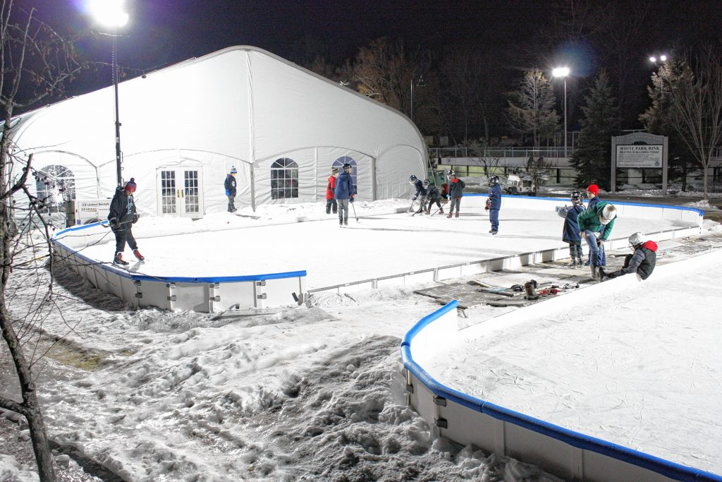 The future generation of Black Icers got to hone their skills on these mini rinks set up by the baseball field. at White Park on Saturday night. JON BODELL / Insider staff