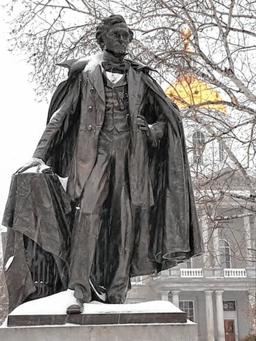 The Franklin Pierce statue chills out on a cold, snowy day in front of the State House.  Courtesy of James W. Spain