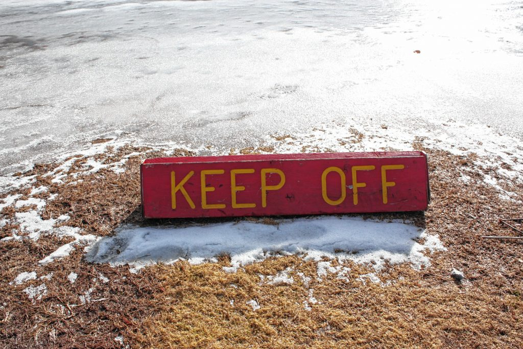 This park has plenty of signage telling you to keep off the ice -- though most of us hope that order gets lifted by Jan. 24 at the latest. JON BODELL / Insider staff