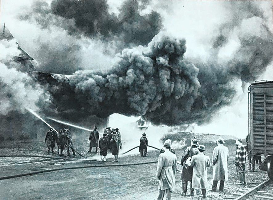 Fire crews battle a major blaze at the Boston and Maine Railroad freight house in Concord some time in the 1940s. The building  and several train cars were destroyed and one firefighter was injured, but nobody was killed. Courtesy of N.H. Historical Society