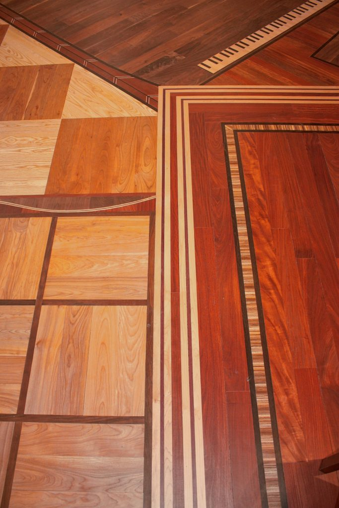 Olde Tyme Craftsmen sells and installs high-end wood floors, stairs and railings. From custom shapes cut into the floor using exotic woods to traditional prefinished hardwood, if you can walk on it, Olde Tyme Craftsmen  can make and install it. JON BODELL / Insider staff