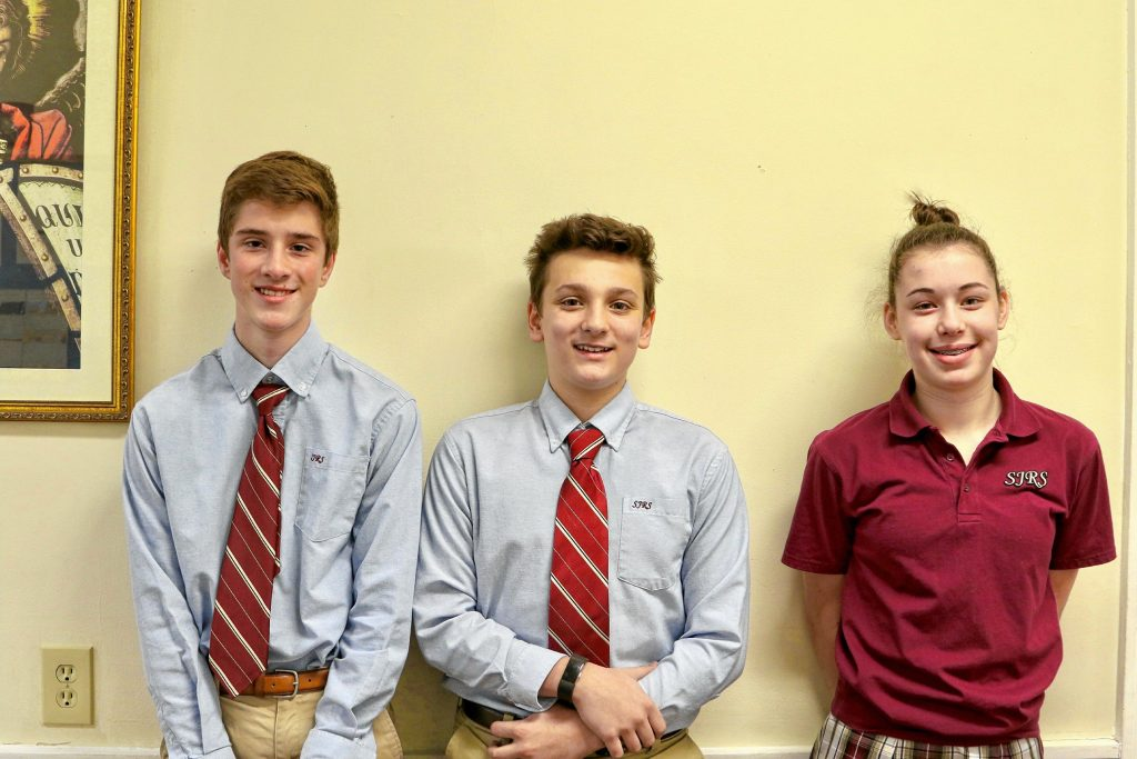 Nathan Steigmeyer (left) finished first in the Geography Bee and was one of 100 students to qualify to go to the State Geography Bee in Keene next month. Michael Thresher (center) placed first in the Spelling Bee and has competed on the state level. (He was not given information as to where he finsihed, but it was not in the top tier.) Morgan Casey finished among the top 10 students in the regional Math Counts held at Keene State College in February. Courtesy of St. John Regional School