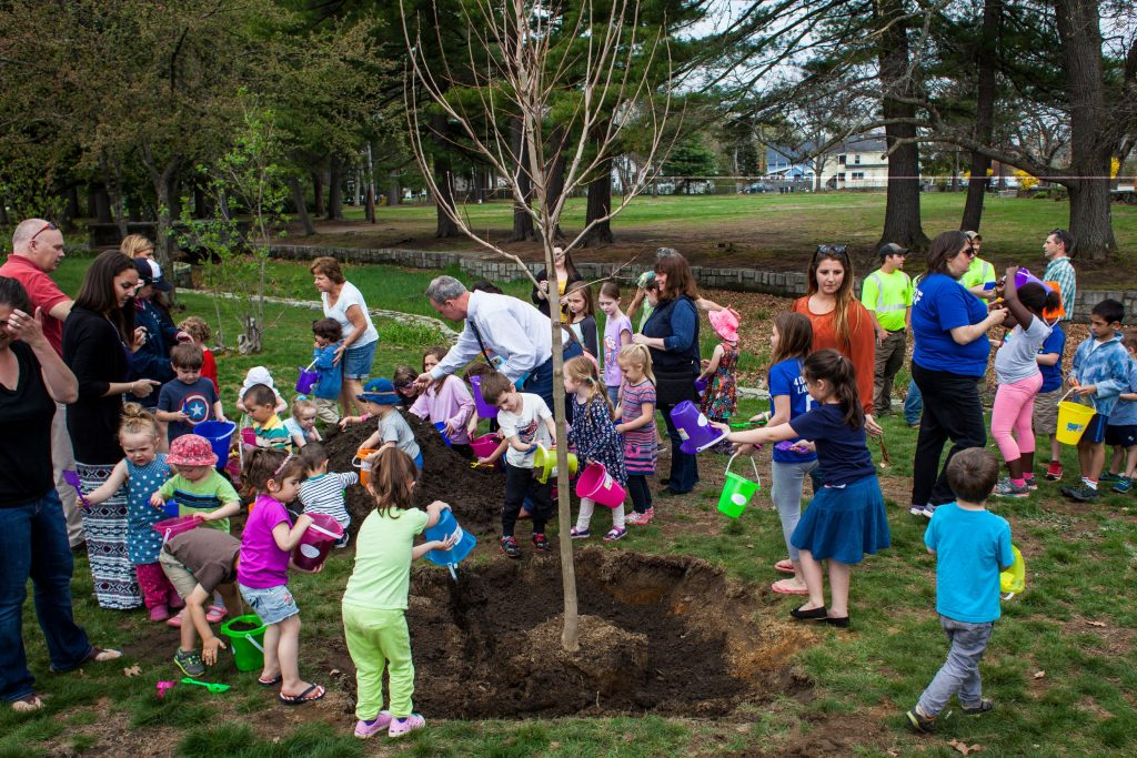 Community children help plant a sugar maple with donated toy buckets and shovels during an Arbor Day celebration at Rollins Park in Concord on Friday, April 28, 2017. (ELIZABETH FRANTZ / Monitor staff) Elizabeth Frantz