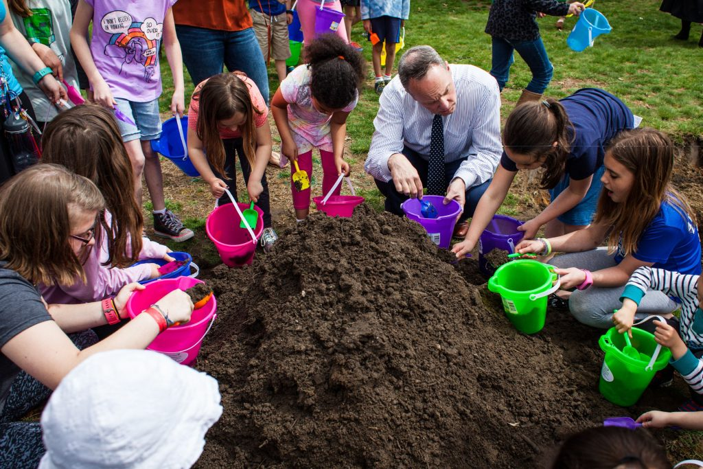 Concord City Manager Thomas Aspell joins community children as they help plant a sugar maple during an Arbor Day celebration at Rollins Park in Concord on Friday, April 28, 2017. (ELIZABETH FRANTZ / Monitor staff) Elizabeth Frantz
