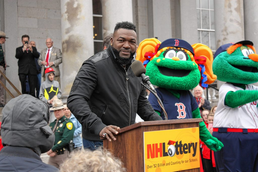 Former Red Sox designated hitter David Ortiz speaks to a crowd in front of the State House during a launch event for a new Red Sox scratch ticket last Wednesday.  JON BODELL / Insider staff