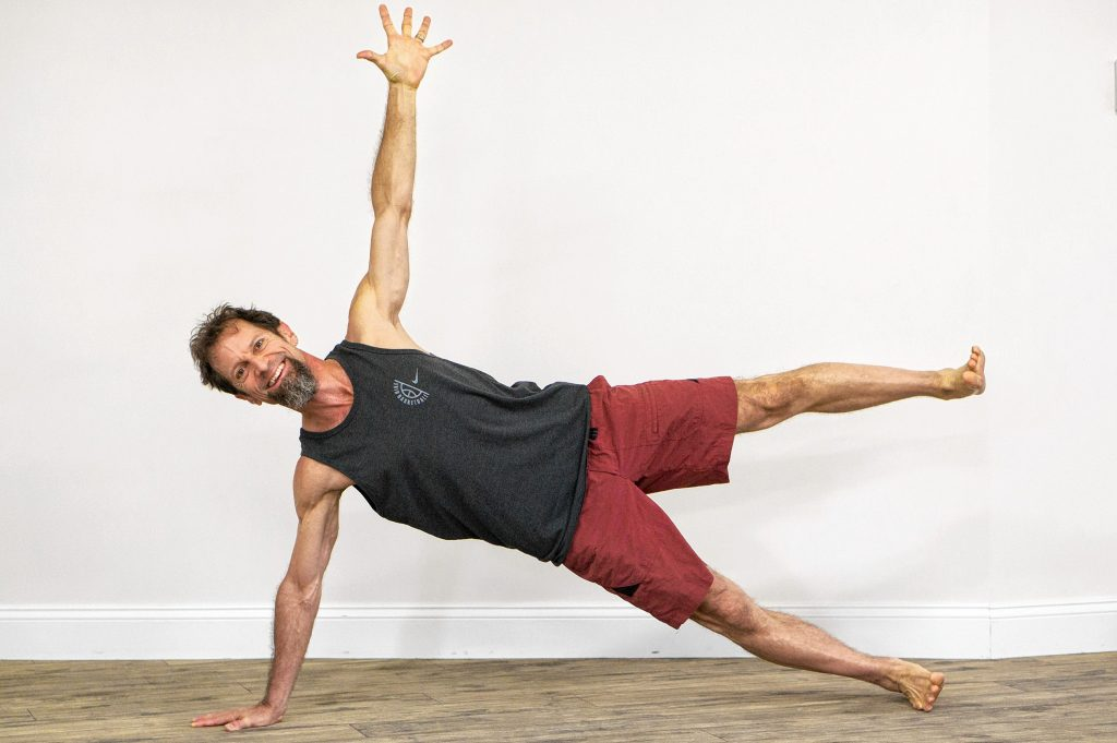 Mike Morris, owner of Hot House NH Yoga and Pilates, shows off his Side Plank pose. Courtesy of Mike Morris