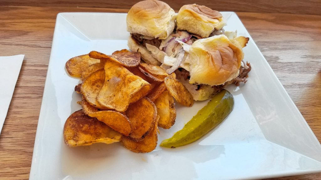 Sweet Baby Ray's BBQ Pulled Pork Sliders with summer slaw and house potato chips from Federal's Cafe. THE FOOD SNOB / Insider staff