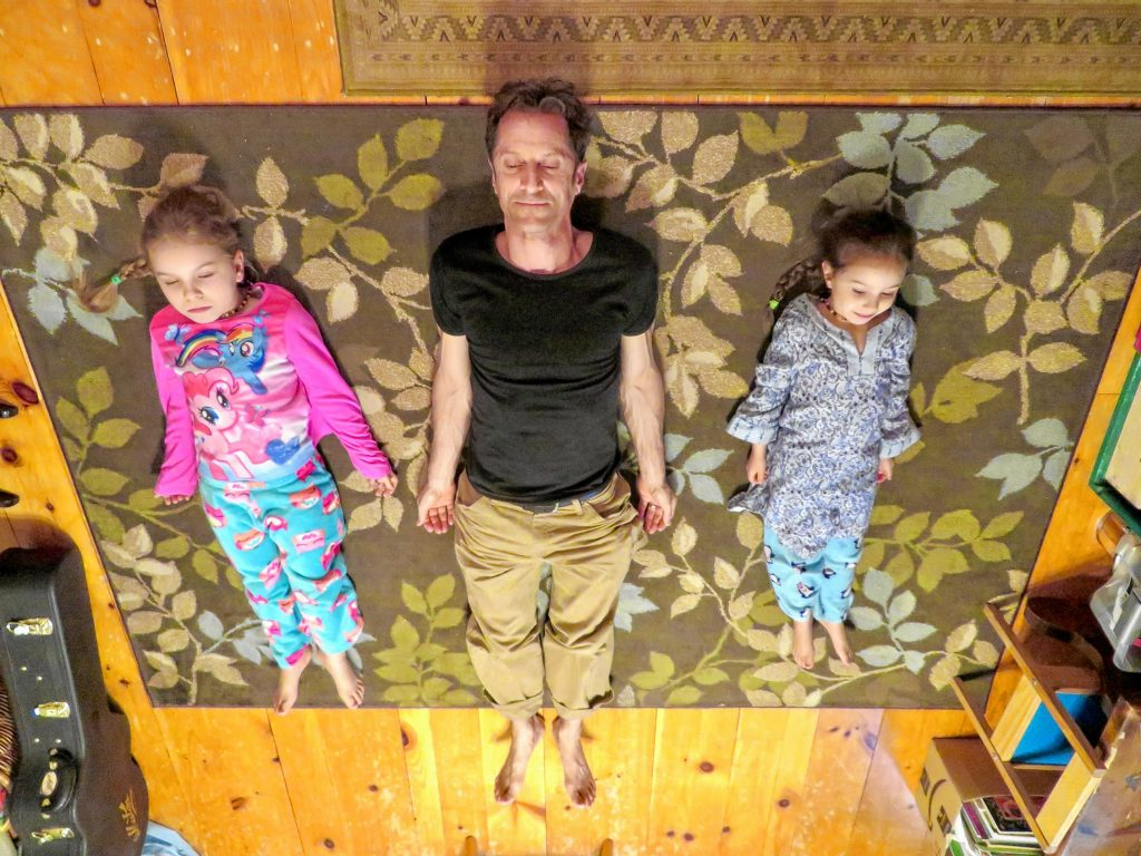 Mike Morris and his daughters needed a little Savasana after jamming out at the Rock 'N Race all night. Courtesy of Mike Morris