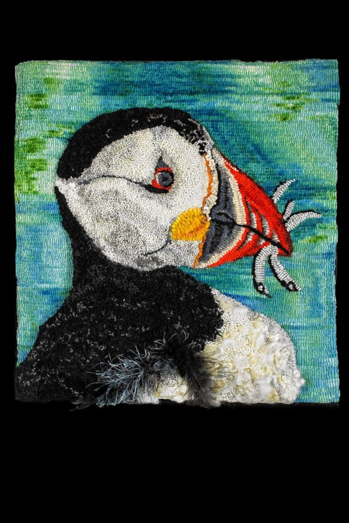 This depiction of a puffin by Sandra Grant of Sunapee will be on display at the League of NH Craftsmen headquarters from June 20 until Sept. 13. Courtesy of League of N.H. Craftsmen