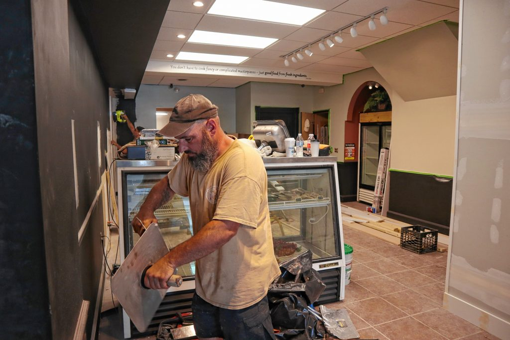 Manager of Cherry Blossom Renovation Jeff Richter works on site of The Crust and Crumb Baking Co. expansion project on Thursday. The Crust and Crumb Baking Co. is expanding into the space where Wellington's Marketplace used to be.