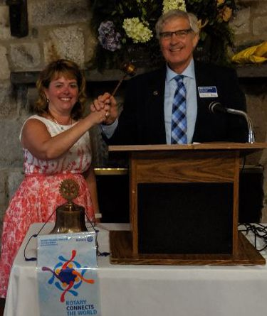 Outgoing Concord Rotary Club President Nancy Parker handed over the leadership gavel on June 25 to incoming President Warren Emley, MD, who assumes the position for the 2019-2020 fiscal year.  Courtesy of Doris Ballard