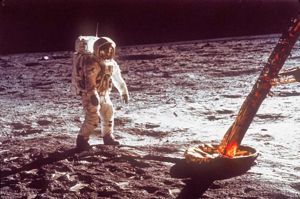 In this July  1969 file photo,  astronaut Buzz Aldrin walks by the footpad of the Apollo 11 Lunar Module. NASA