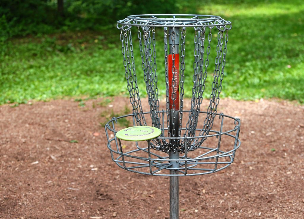 Making it into the chain basket is the goal for disc golfers. This one can be found near the entrance at the Top O' The Hill Disc Golf Course in Canterbury.