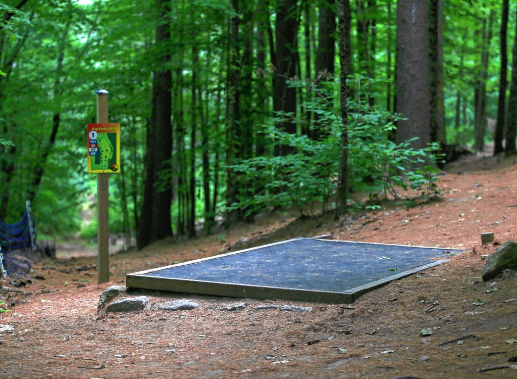 If you make your way through the woods at Top O'The Hill Disc Golf Course in Canterbury, you'll quickly come across the first tee box.