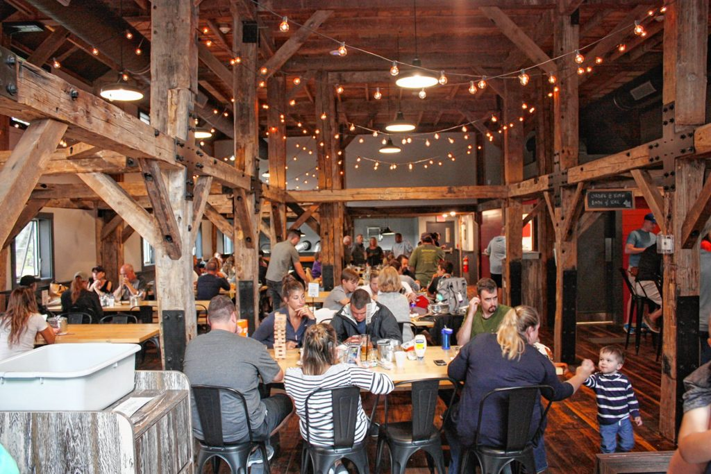 It's barely a month old, but Twin Barns Brewing in Meredith has already become a very hot spot for craft brews and classic comfort food in the Lakes Region. JON BODELL / Insider staff