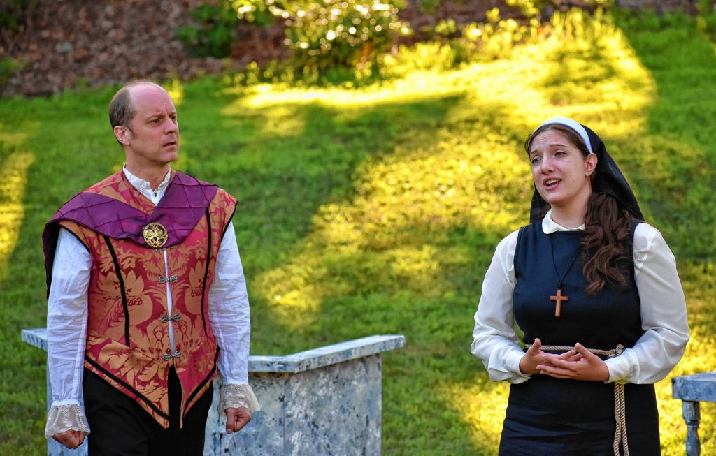 Jake Berger as Angelo and Ellie Bartz as Isabella act out a scene from Advice To The Players' 20th Anniversary Summer Mainstage Production of William Shakespeare's 'Measure for Measure,' to be performed at Eagle Square on Friday. Diana Evans