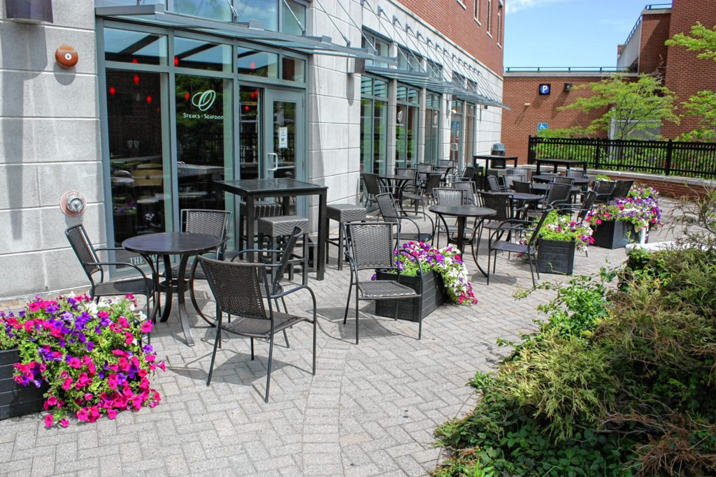 O Steaks & Seafood offers a classy patio tucked back from the sidewalk on South Main Street with seats for 42 people . JON BODELL / Insider staff