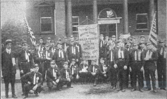 The Brotherhood of Boiler Makers Lodge 245 from Concord on Labor Day, 1915, in front of the Wonalancet Club in Concord, just after marching in the Concord Labor Day Parade.