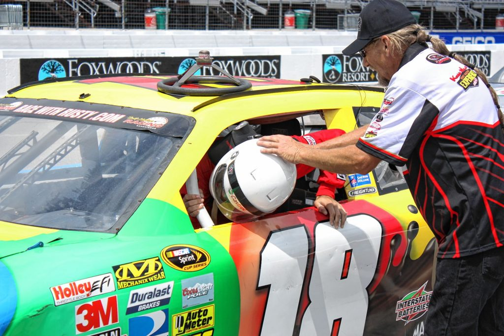 A staffer helps me climb into my race car at New Hampshire Motor Speedway. Christian Bodell / For the Insider