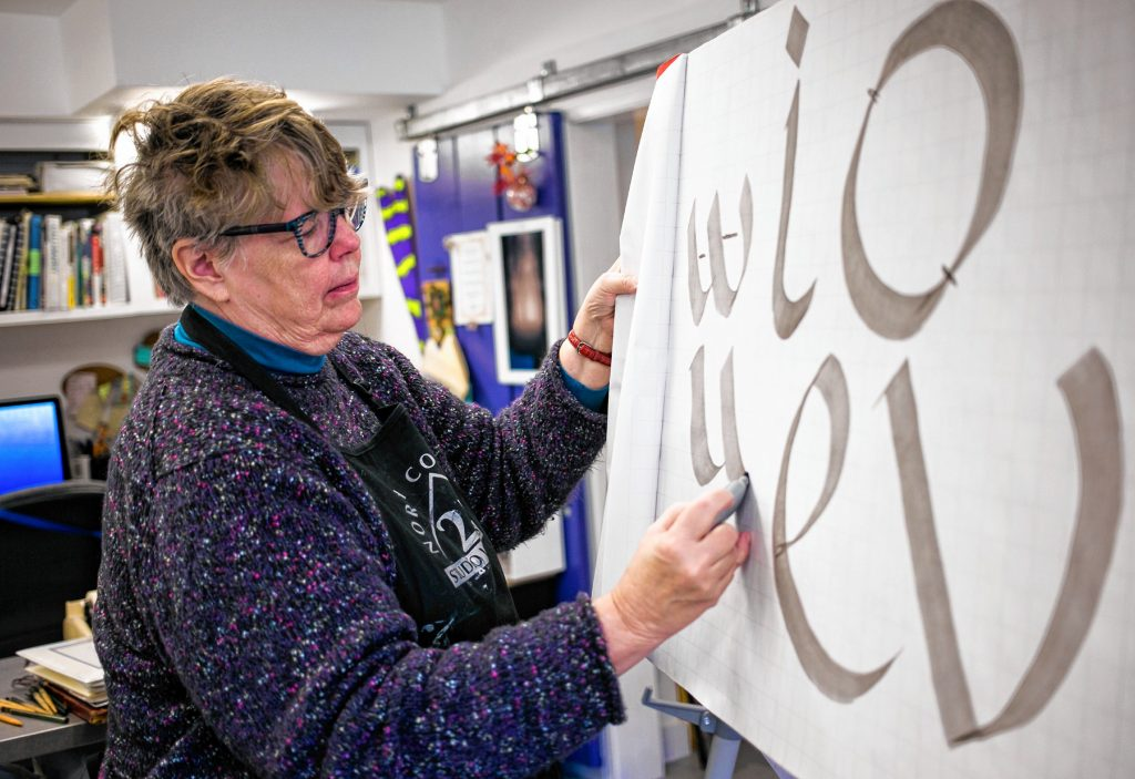 Adele Sanborn shows how to make a 'W' during her introductory calligraphy class at the Twiggs Gallery in Boscaswen last weekend. Sanborn says the 'W' is the most difficult letter to produce.