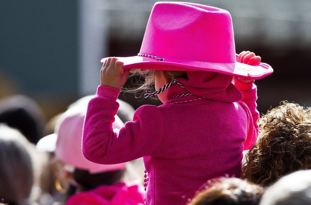 A young girl dones all pink at the Making Strides against Breast Cancer Walk at Memorial Field Sunday. (GEOFF FORESTER / Monitor staff