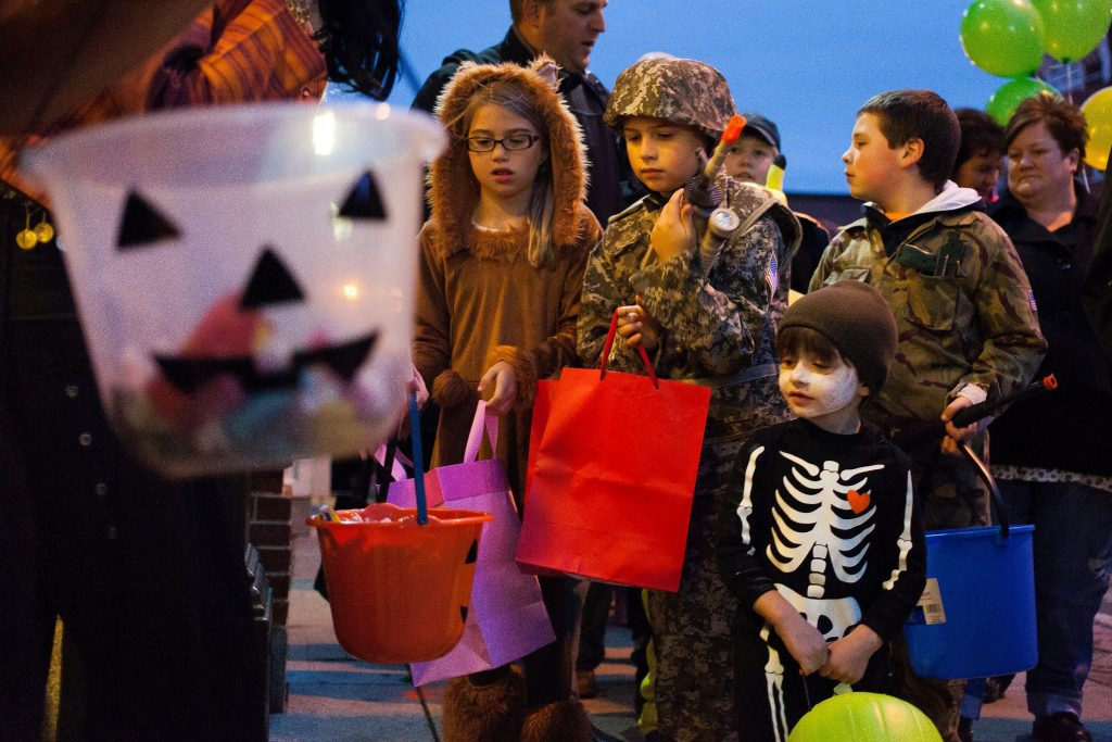Will Garneau, 3, of Concord (bottom center) trick-or-treats in his funny bones skeleton costume during the annual Downtown Halloween Howl on Main Street in Concord on Friday, Oct. 24, 2014.  (ELIZABETH FRANTZ / Monitor staff) ELIZABETH FRANTZ